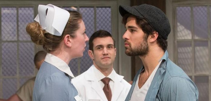 Erin Cassidy and Marksian Tarasiuk face off as Ratched and McMurphy in the Studio 58 production of One Flew Over the Cuckoo's Nest. Photo by David Cooper.