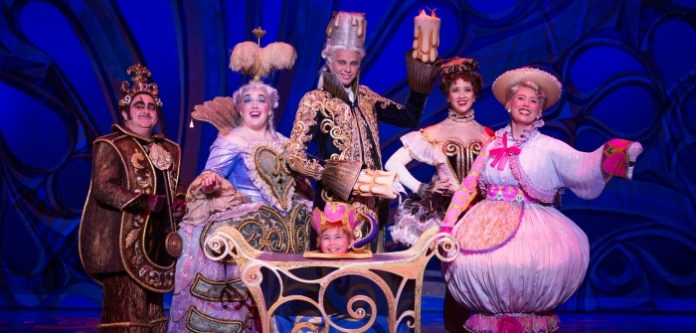 Patrick Pevehouse (center) plays Lumiere in the touring production of Beauty and the Beast. Photo by Matthew Murphy.
