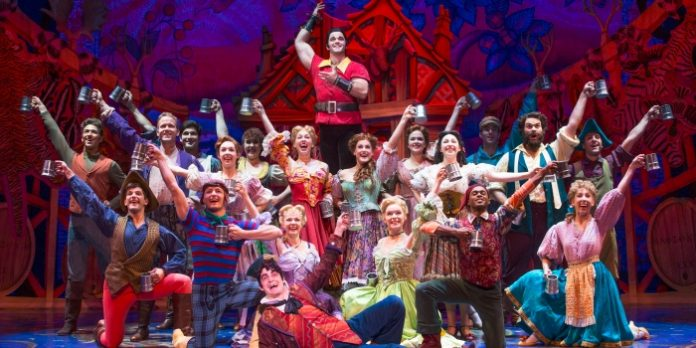 Cameron Bond as Gaston and members of the cast of Disney's Beauty and the Beast. Photo by Matthew Murphy.