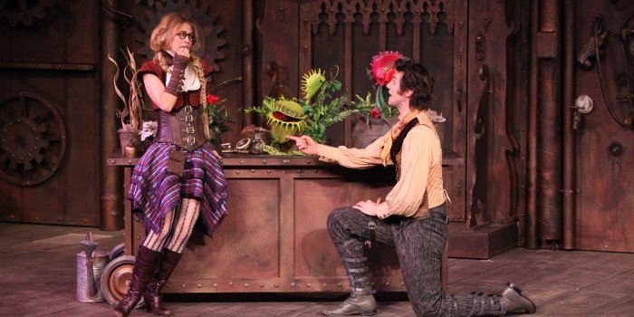 Lindsey Angell and Ben Elliott play to a flesh eating plant in the Bard on the Beach production of The Comedy of Errors. Photo by David  Blue.