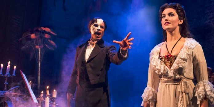 Derrick Davis and Eva Tavares in the touring production of The Phantom of the Opera. Photo by Matthew Murphy.