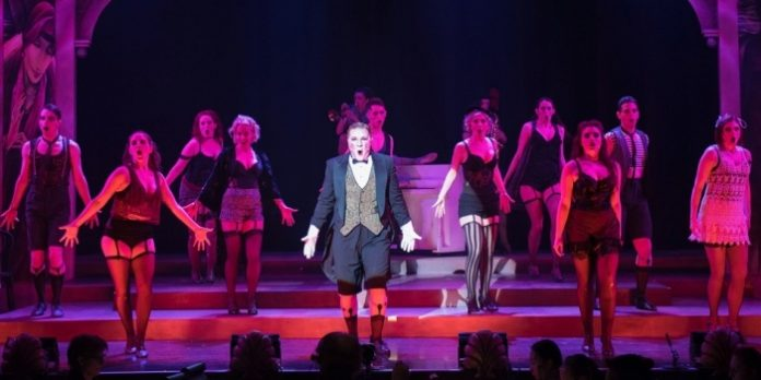 Andrew Cownden as The Emcee and the Kit Kat Boys & Girls in the Royal City Musical Theatre production of Cabaret. Photo by Emily Cooper.