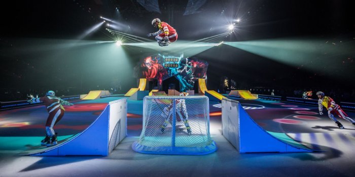 """""""Playground"""" is a hockey game turned human pinball match, complete with ceiling to ice sized drops, that left the audience clutching their metaphorical pearls. Photo by Matt Beard."""