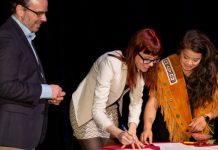 In a ceremony earlier this month, Indigenous playwright Kim Senklip Harvey (right) signed a living treaty with Vancouver's Arts Club Theatre Company and Edmonton's Citadel Theatre, represented here by Daryl Cloran (left) and Ashlie Corcoran (centre). Photo by Mark Halliday.
