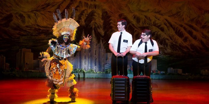 In The Book of Mormon, Elders Price and Cunningham (Kevin Clay & Conner Peirson above right) are assigned to convert the people of Uganda who are more concerned with poverty, AIDS and their ruthless military leader. Photo by Julieta Cervantes.