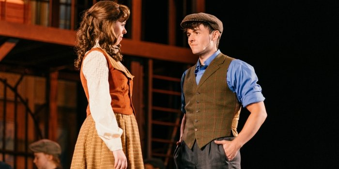 Julia Ullrich as Katherine Plumber and Adam Charles as Jack Kelly in the Theatre Under the Stars production of Disney's Newsies. Photo by Lindsay Elliott.