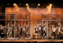 The cast of the Theatre Under the Stars production of Disney's Newsies. Photo by Lindsay Elliott.