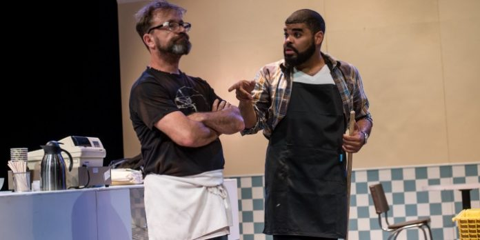 David Nykl and Chris Francisque in the Ensemble Theatre Company of Superior Donuts. Photo by Zemekis Photography.