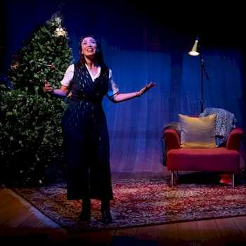 Melissa Oei in the Arts Club production of The Twelve Dates of Christmas. Oei shares the role with Genevieve Fleming. Photo by Moonrider Productions.